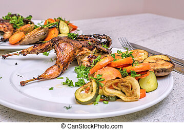 Roasted homemade quail with vegetables. Healthy food....