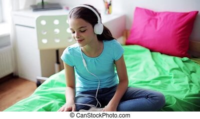 girl in headphones listening to music at home - people,...
