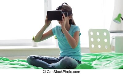 happy girl in vr headset or 3d glasses at home