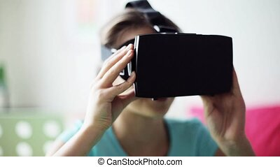 happy girl in vr headset or 3d glasses at home - technology,...