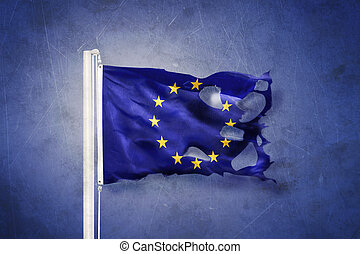 Torn European Union flag against grunge background.