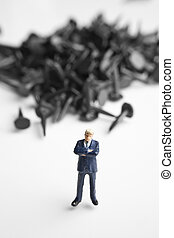 Businessman figurine & tacks - Businessman figurine placed...