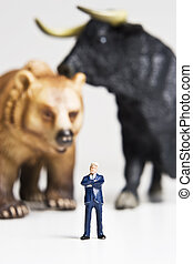 Business, bull & bear figurines - Business figurines placed...