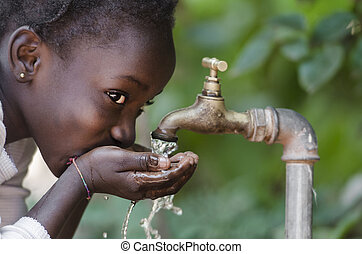 Beautiful African Child Drinking from a Tap (Water Scarcity...