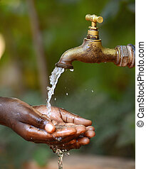 Water Scarsity Symbol - Drinking for African Children. Water...