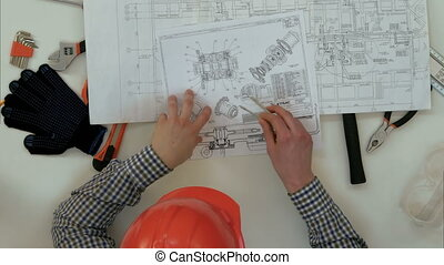 Architects checking blueprints with divider compass and...