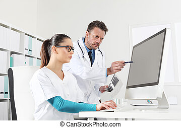 Doctor and nurse use the computer, concept of medical consulting