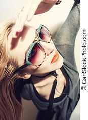 Woman wearing sunglasses - Portrait of woman wearing...