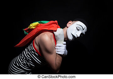 Mime with colorful shopping bags