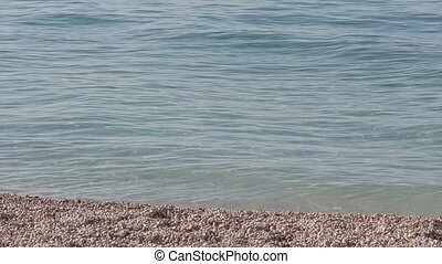 Adriatic sea beach - The small waves on the surface of the...