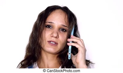 Young beautiful woman with curly hair talking mobile phone...