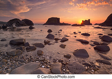Sea stacks near Ballintoy Harbour in Northern Ireland at...