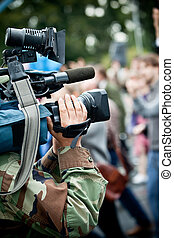 News maker on reportage recording with camcode