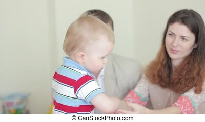 baby and happy parents - Portrait of a young happy family...