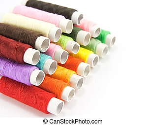 Spools of color thread on white background