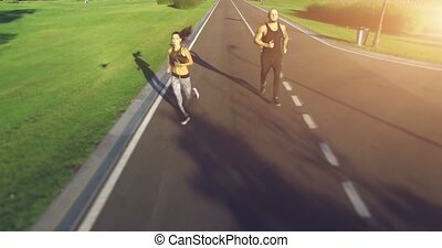 Couple jogging in the park - Young couple running in the...