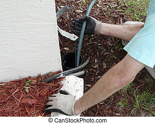 Using Sewer Rod to Clear Blockage - Homeowner uses sewer...
