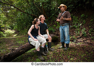 European and American couple with nature guide - Couple with...