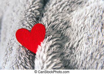 Valentines day red heart on bedspread with copy space.