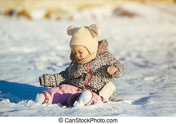 Little girl sitting in the snow - Beautiful little baby girl...