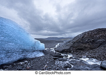 Glacier in rugged terrain - The side of a melting glacier in...