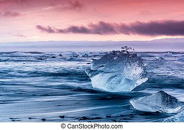 Iceberg on Jokulsarlon glacial lagoon beach - An iceberg...