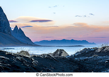 Dramatic Iceland oceanfront mountain scenery - A volcanic...