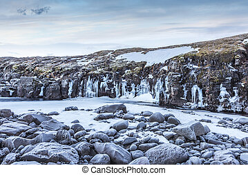 Frozen River in Iceland's highlands - A frozen river in the...