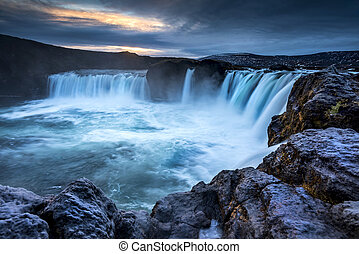 Waterfall in Iceland - Godafoss Falls at Sunrise shows the...
