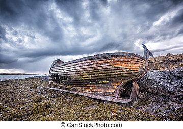 Old wooden ship on beach - An old abandoned fishing vessel...
