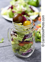 mason jar salad - a salad with a mix of different lettuces,...