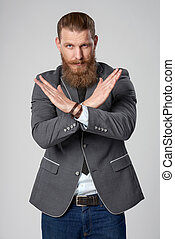 Business man gesturing enough denial sign - Serious hipster...