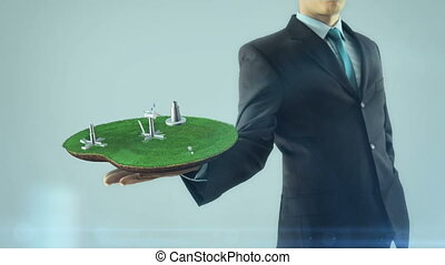 Business man has on hand green energy concept build animation solar panel and windmill