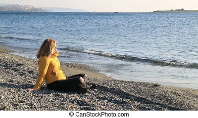 Middle aged woman resting at winter beach - Relaxed middle...