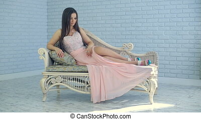 Beautiful woman on sofa