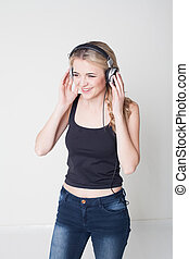 girl with head-phones listening to music - Portrait of young...