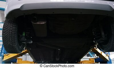 Automobile service - mechanic wrapping working device under...