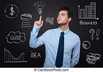 Handsome young man presenting business ideas. - Business...