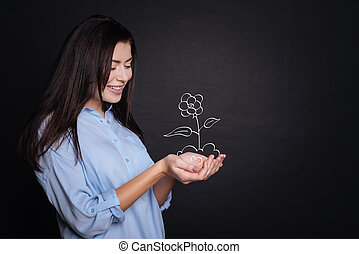 Cheerful young woman holding flower - Love nature. Cheerful...