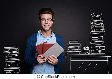 Joyful young man holding diaries.