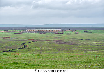 Pastoral landscape with distant farm and cowshed - Beautiful...