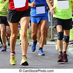many people run fast during sports race through the streets