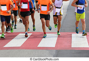 pedestrian crossing with lots of runners during sports race...