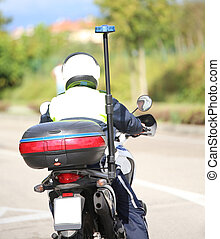 policeman with helmet on the police motorcycle while...