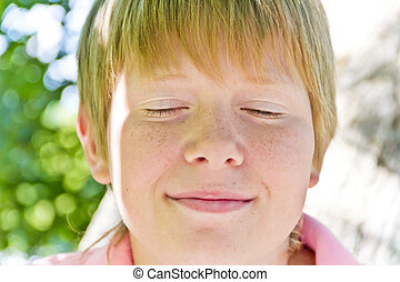 Boy with close eyes - Portrait of blond boy with close eyes...