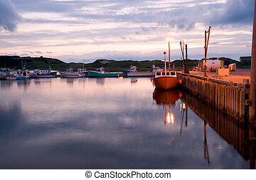 Sunset over harbor - Boats in Inverness harbor, Cape Breton,...