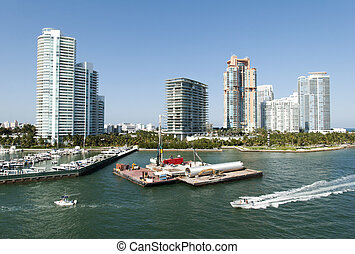 Miami Beach Skyline - The view of boats passing by Miami...