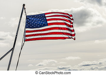 stars and stripes in sun with cloudy white background