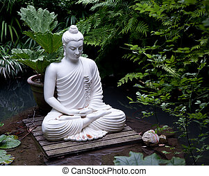 Buddha statue in pond - Statue of Buddha on wooden platform...