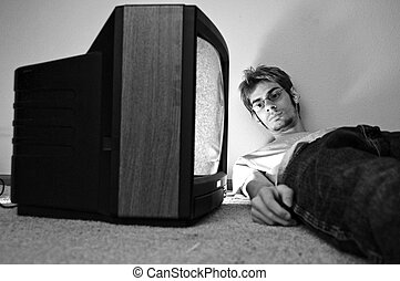 Watching TV on the floor - An old CRT TV plugged into the...